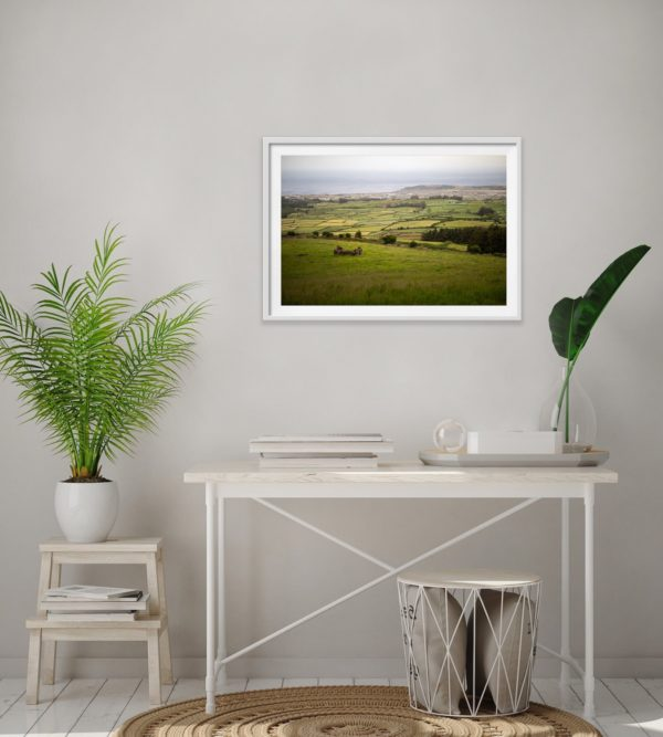 Azorean patchwork of farm fields in the Azores, Portugal. Framed in white