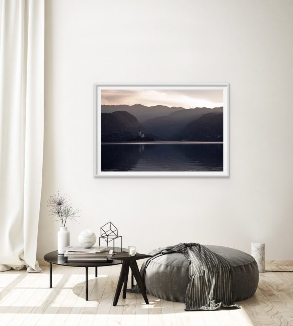The late afternoon glow lights up the iconic church on the small island in Lake Bled. Framed in white