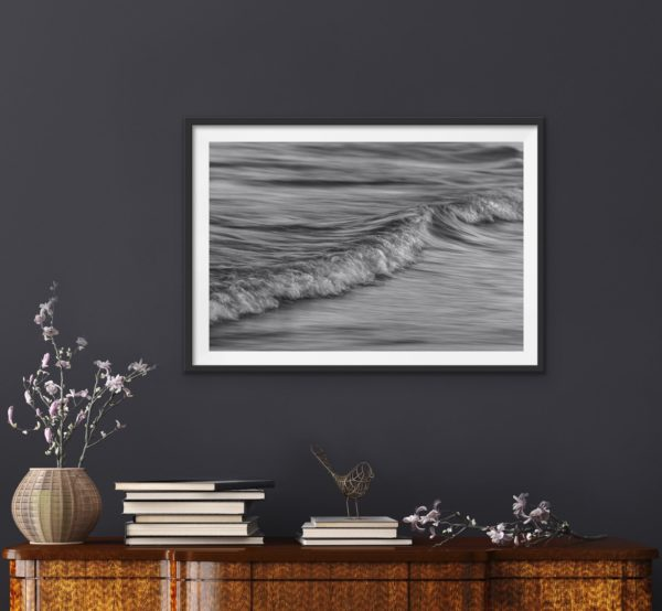 Abstract black and white photo of the ocean in a black frame