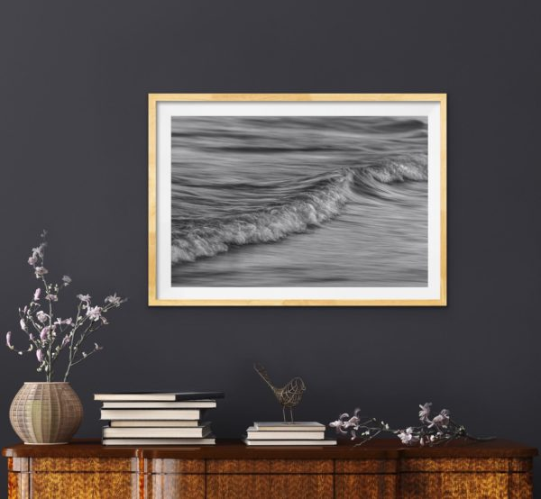 Abstract black and white photo of the ocean in a Tasmanian oak frame
