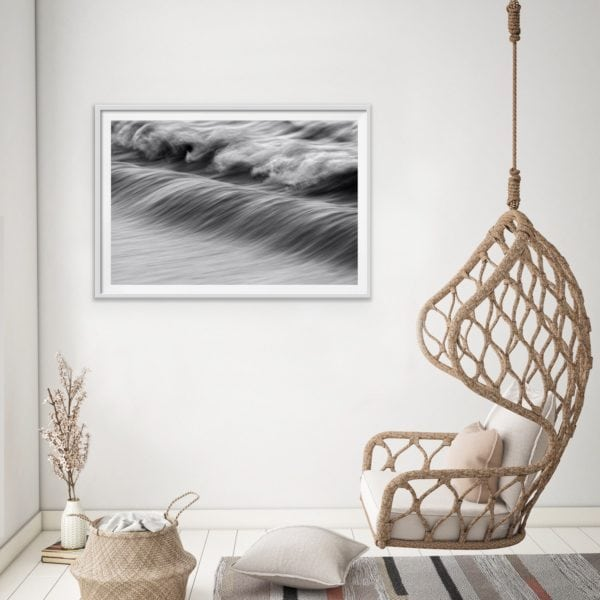 Abstract black and white photo of the ocean in a white frame