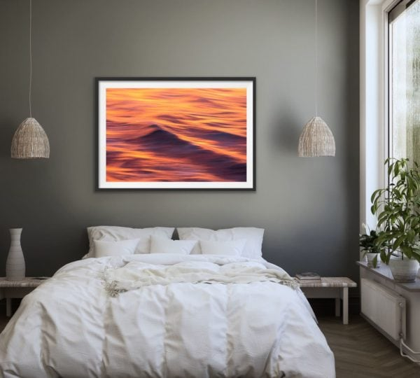 Fire & Water II - an abstract image of sunset reflected on the waves of the ocean framed in black