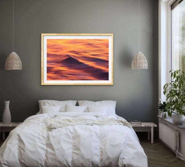 Fire & Water II - an abstract image of sunset reflected on the waves of the ocean framed in Tasmanian oak