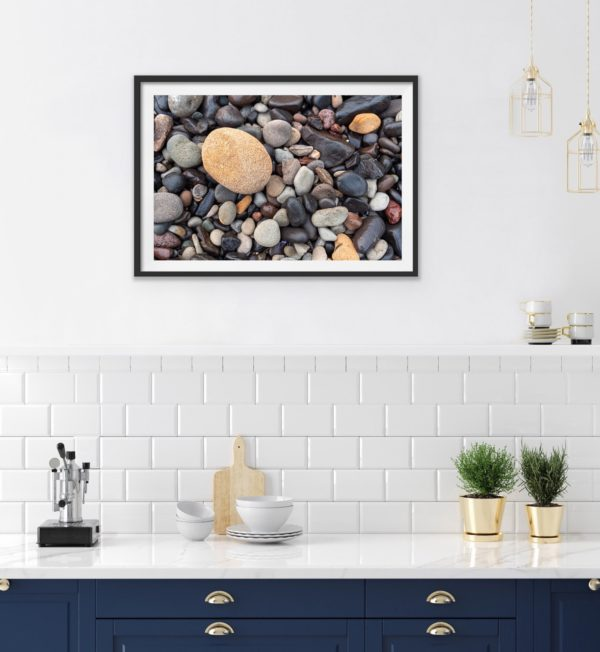 An abstract photo of pebbles. Framed in black