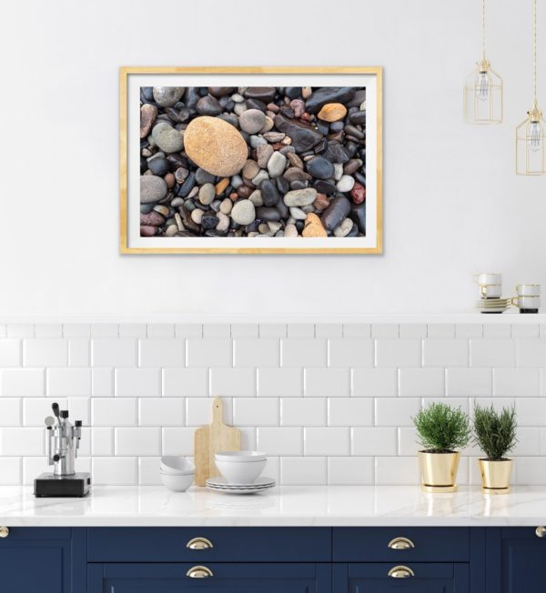 An abstract photo of pebbles. Framed in Tasmanian oak