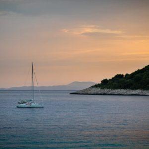 Sunset sailing - a yacht at sunset off the coast of Hvar in Croatia.
