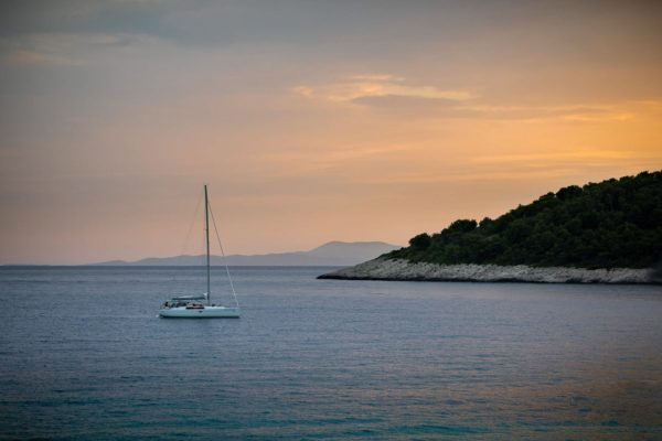 Sunset sailing - a yacht at sunset off the coast of Hvar in Croatia.