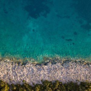 Aerial photo of coda (water) and ocean shoreline in Croatia