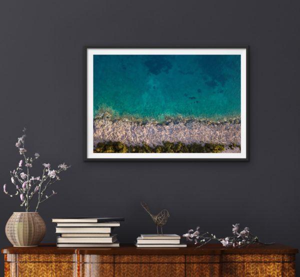 Aerial photo of coda (water) and ocean shoreline in Croatia framed in black