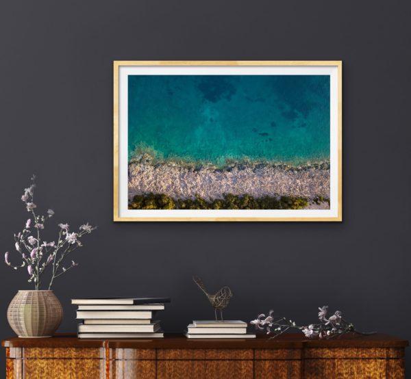 Aerial photo of coda (water) and ocean shoreline in Croatia framed in Tasmanian oak