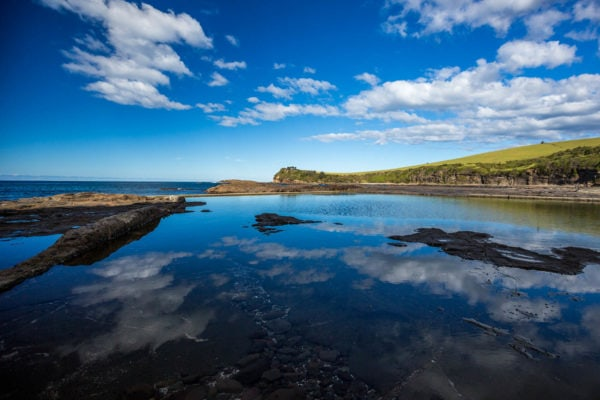 The blue sky reflecting in the water of Gerringong's Boat Harbour