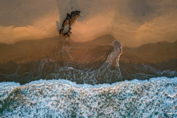 An aerial view of Jones Beach at sunrise
