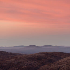 Alps Sunrise - A soft alpine sunrise dusts the rolling peaks of Kosciuszko National Park, Australia