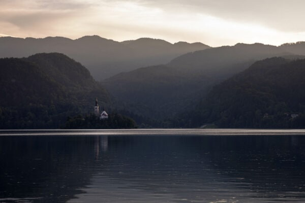 Bled - The late afternoon glow lights up the iconic church on the small island in Lake Bled, Slovenia.