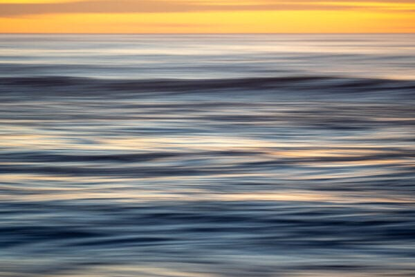 An abstract photo of the ocean which resembles brushstrokes.
