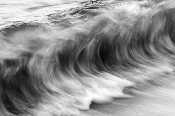 The ocean's movement - textures resembling charcoal sketches.