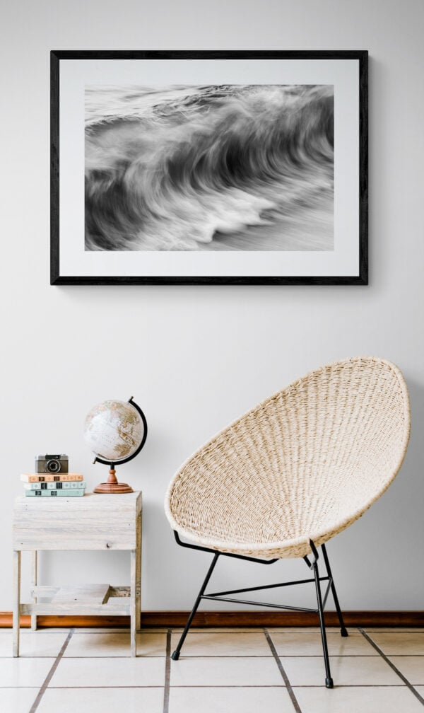 The ocean's movement - textures resembling charcoal sketches. Framed in black