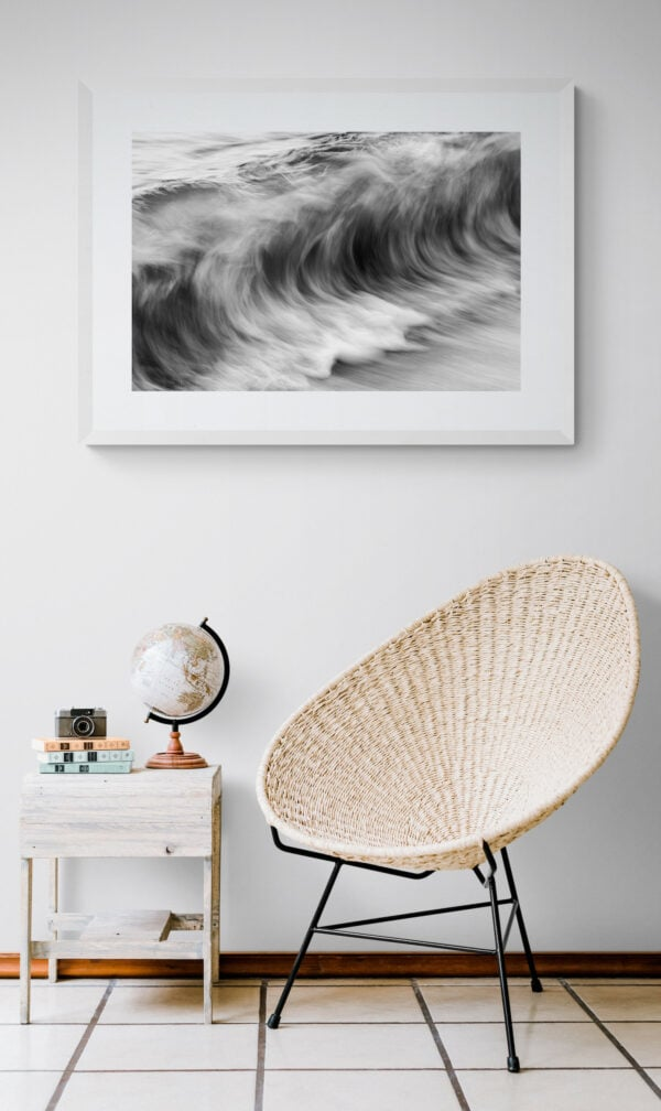 The ocean's movement - textures resembling charcoal sketches. Framed in white