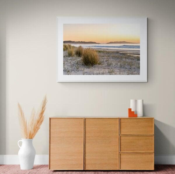 Sunrise on a deserted South Coast beach. Framed in white
