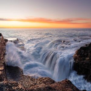 Red Cliff Sunrise - sunrise lights up the ocean and rock platform